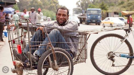 SouthAfricanManinBikeGroceryBasket.jpg